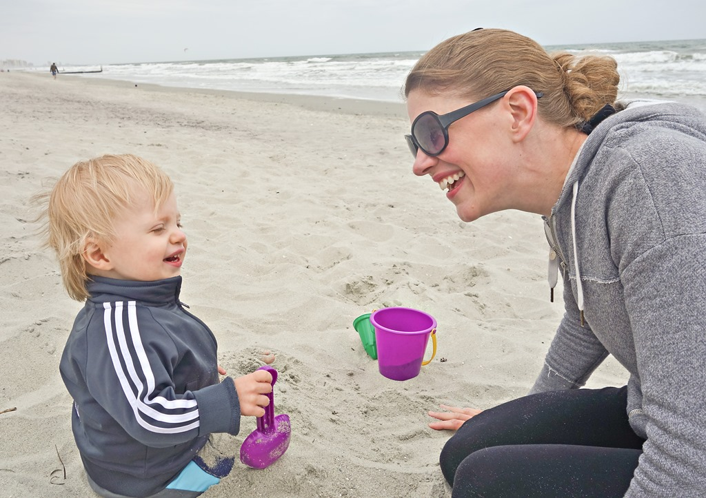 Mother-and-Child-Laughing-on-Beach